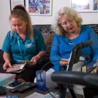Carole And Dani Looking At Photos